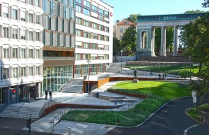 A distant view of the place and gate showing the winding path, steps and sitting areas in Schandorff Square.