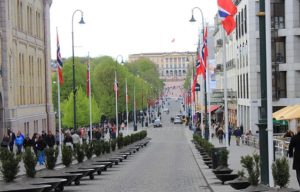 long view down a cobbled street to the Norwegian palace building