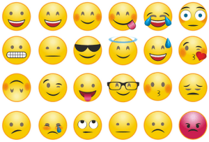 Set of emoji faces depicting various emotions from happy to sad, and angry to loving.