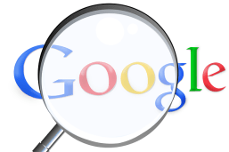 The Google trade mark name has a magnifying glass held over it.