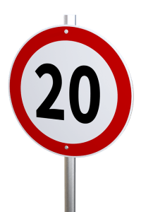 A red and white circular sign with a 20 speed limit showing.