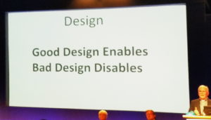 Slide at a universal design conference with the words, good design enables. Bad design disables.