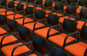 Rows of empty seats at a conference venue.