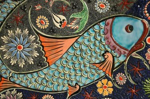 A decorative design that looks like a fish and flowers.