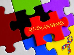 A brightly coloured logo in the style of a jig saw puzzle for Autism Awareness.