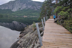 A boardwalk traverses a rocky slope down to the lake making it accessible for everyone.