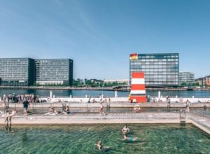 A sunny day in Copenhagen brings out the swimmers at the outdoor baths that are edged with timber boardwalks.