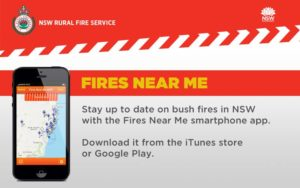 A smartphone with a map and wording of Fires Near Me. It is the app of the NSW Rural Fire Service.