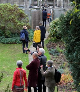 Photo from the Design Council report showing people walking through a garden.