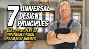 Mike Holmes stands in work gear with his muscled arms folded, smiling at the camera. A builder's view of UD.