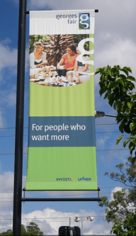 "A banner advertising home and land packages. It says, ""for people who want more""."