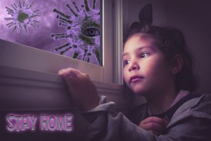 A girl looks longingly out of the window. Outside coronavirus elements float in the air.