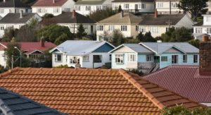 Residential homes sit side by side in the landscape.