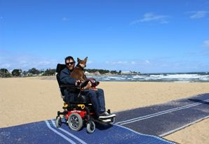 A wheelchair user has access to the beach with the Council beach mat. Standards for tourism.