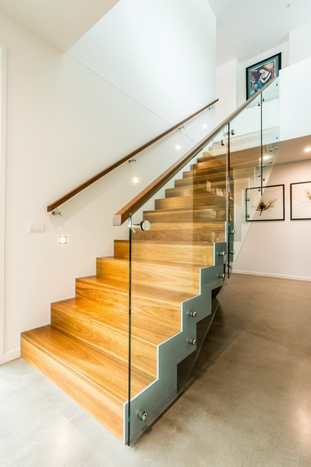 Timber staircase with handrails both sides.