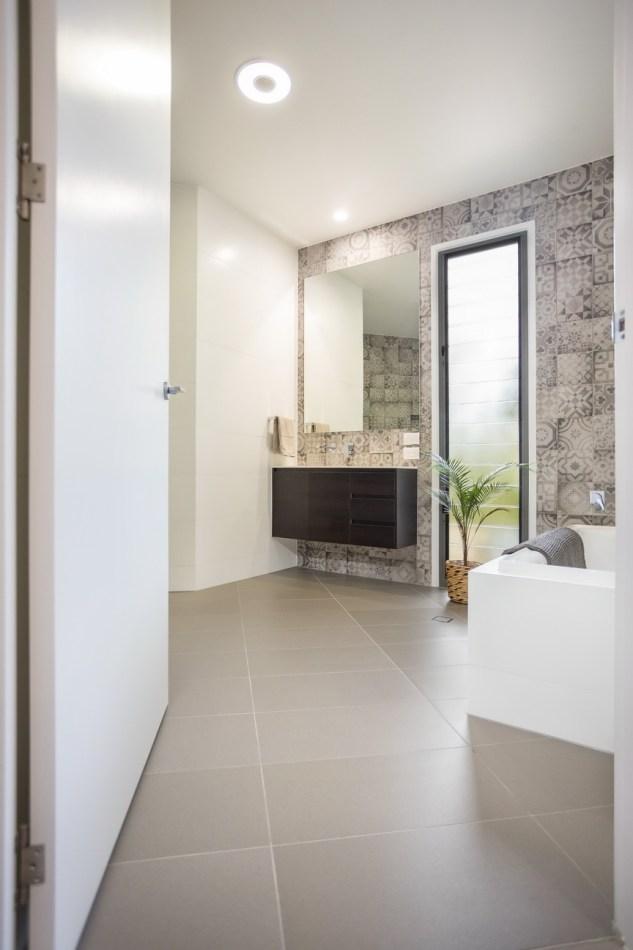 View into the bathroom through a wide door.
