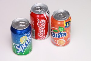 Three soda cans showing the ring pull opener. Older adults lead universal design.