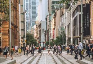 A view of George Street Sydney showing pedestrians walking across the mall created by the light rail system. Ageing is not just a health issue.