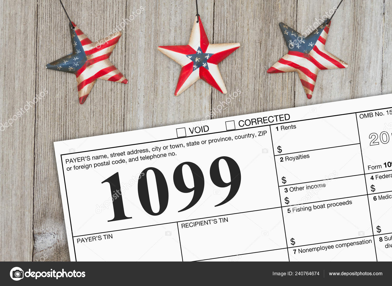 A Us Federal Tax 1099 Income Tax Form On Weathered Wood With Usa Stars