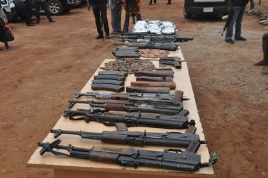The Police Public Relation Officer, ACP Jimoh Moshood parading weapon recovered from some Gunrunners and Kidnapers in Benue State who had link with Gana gang yesterday. Photo by Gbemiga Olamikan.