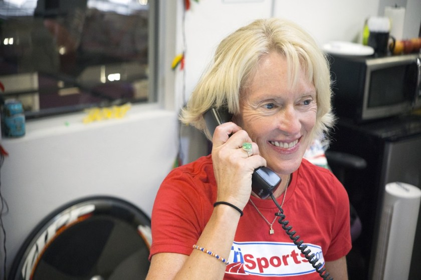 Pam on the phone with customers