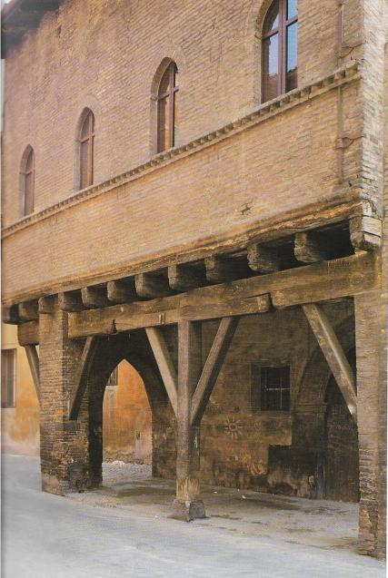 House with brick and wooden pillars in Begatto street , Bologna