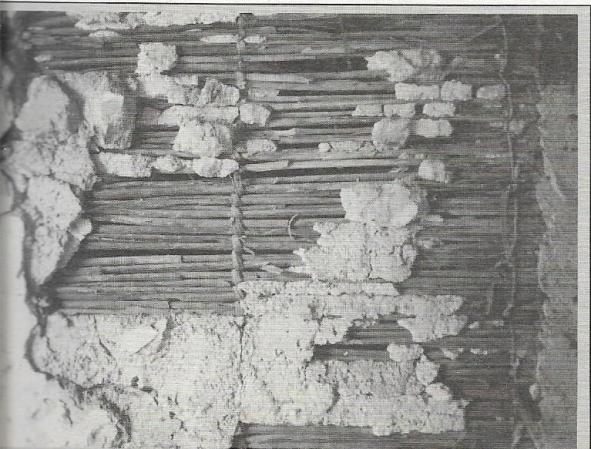 Detail of vertical partition with arelle mat wall: detail of bindings and plaster layers with finer lime plaster on top
