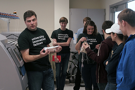 Kevin Wolfgang, manager of the Tech Style LAB, explains how the knitting machine works. Photo by Laurie Moore.