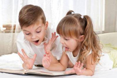 bigstock-Children-with-book-18086657