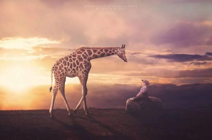 bimbo con giraffa