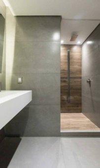 Um dos banheirosFoto: Marcelo Donadussi / ©Marcelo Donadussi Leia mais: https://oglobo.globo.com/ela/decoracao/cozinha-preta-iluminacao-cenica-sao-detalhes-que-dao-sofisticacao-apartamento-de-solteiro-21351321#ixzz4hb3Op662 stest