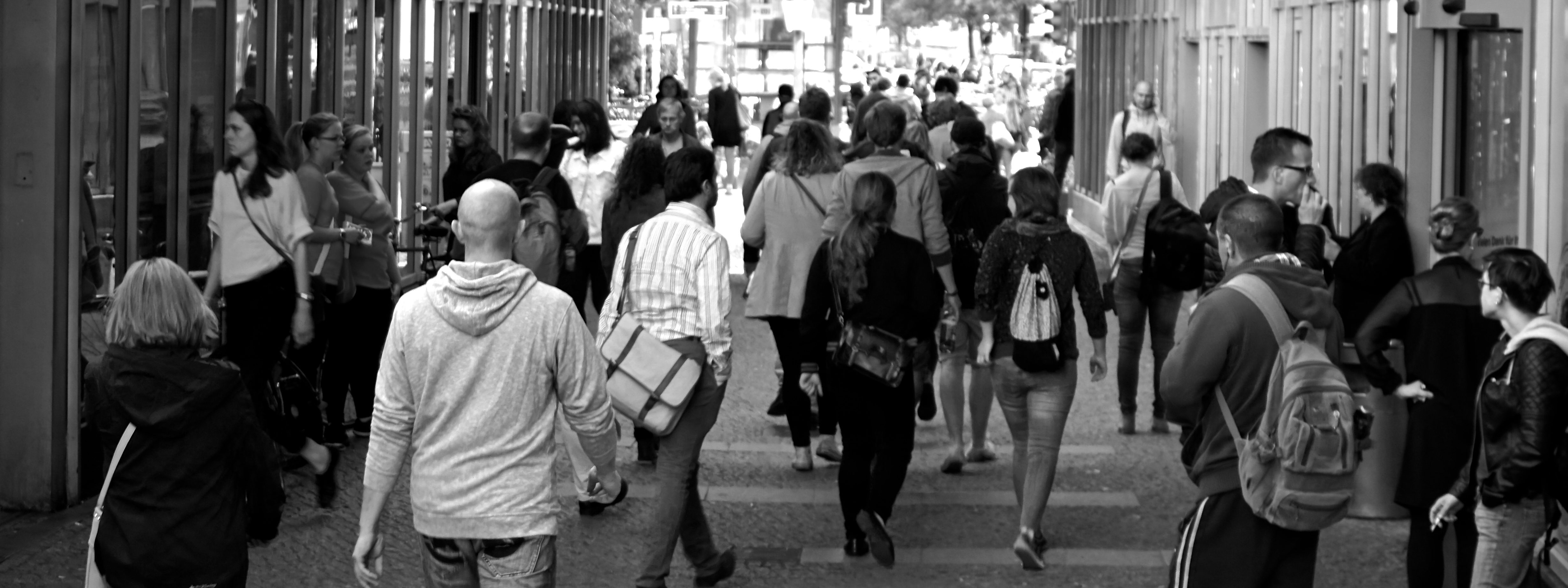 Photo of a crowd of people on a busy street.