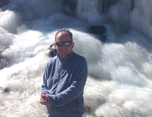 Posing in front of frozen waterfall