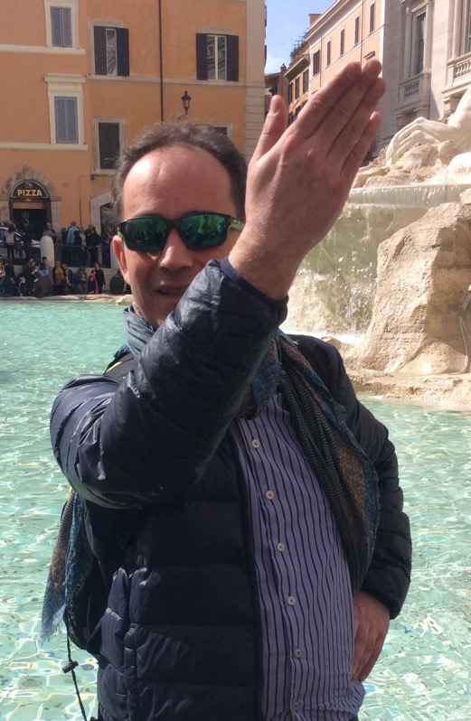 View of author tossing a coin into the Trevi Fountain