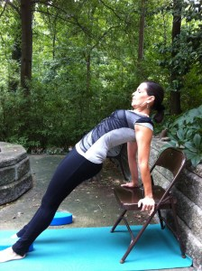Reverse plank on chair with yoga egg at feet