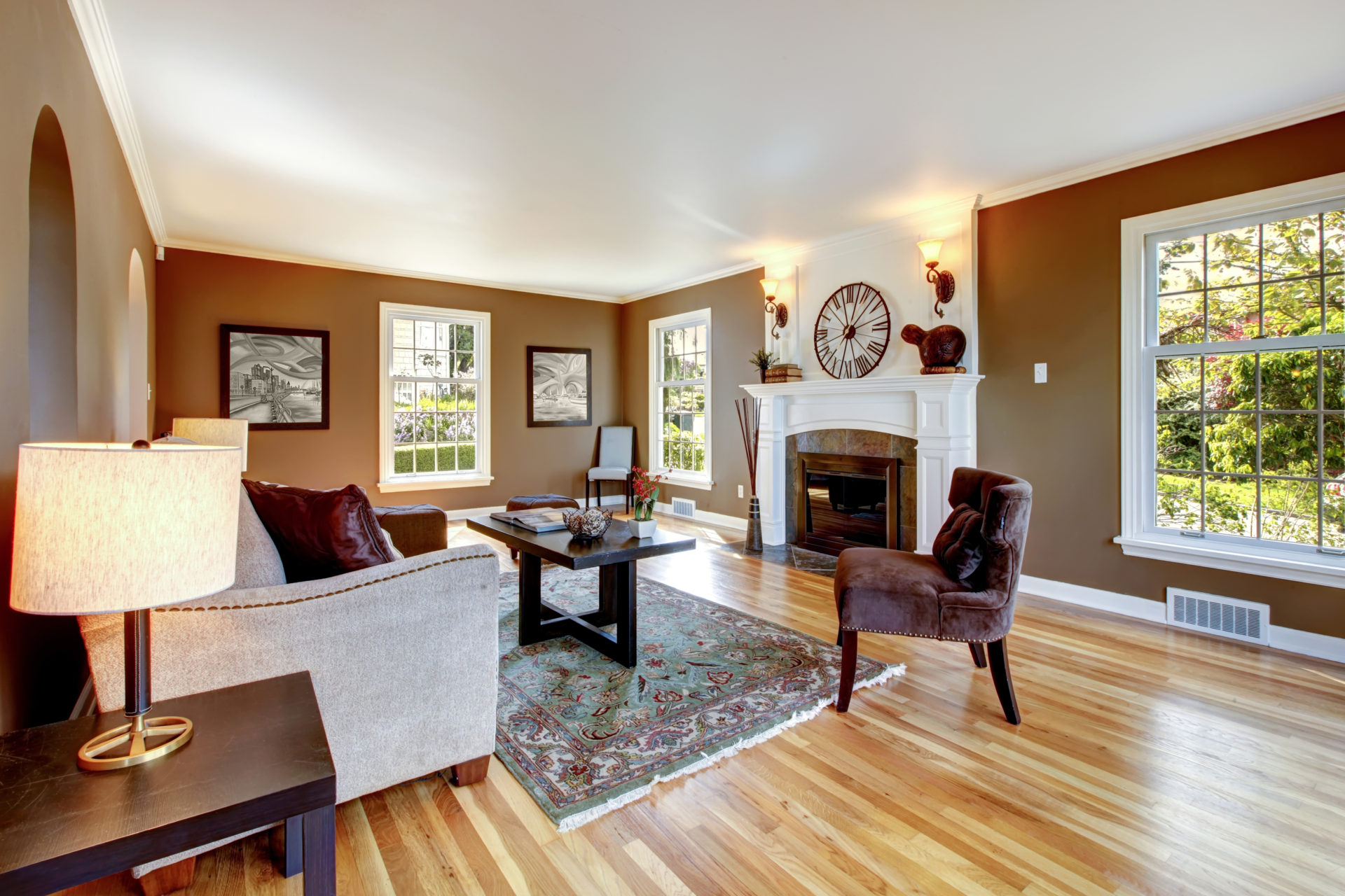 Classic brown and white living room interior with hardwood floor.