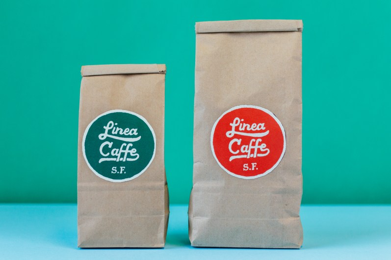 Red and green Linea Caffee coffee bag designs.