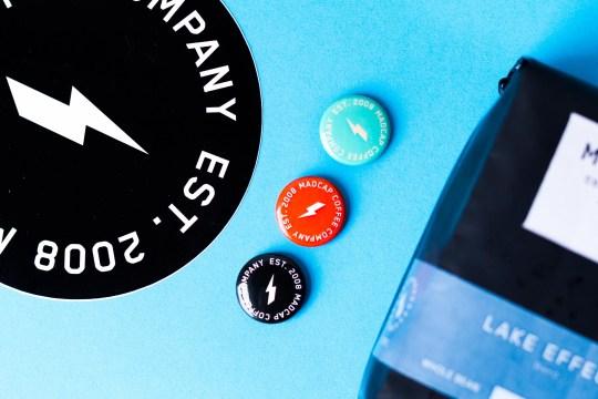 Madcap Coffee Company's Logo Buttons.