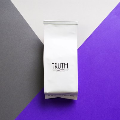 Truth coffee back on purple, grey and white background