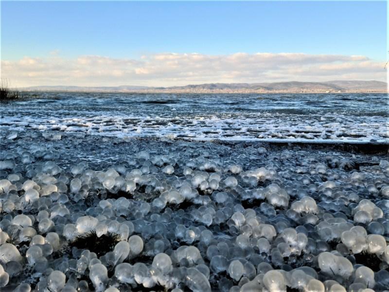 frozen glass balls on the beach at Balatonbereny