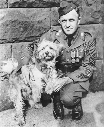 A photograph of Rags with his surviving rescuer, First Sergeant George Earl Hickman, 16th Infantry, at Fort Hamilton circa 1930.