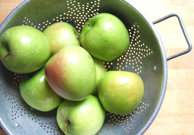 green apples in colander