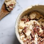 pecan sugar shortbread dough on marble with wooden spoon