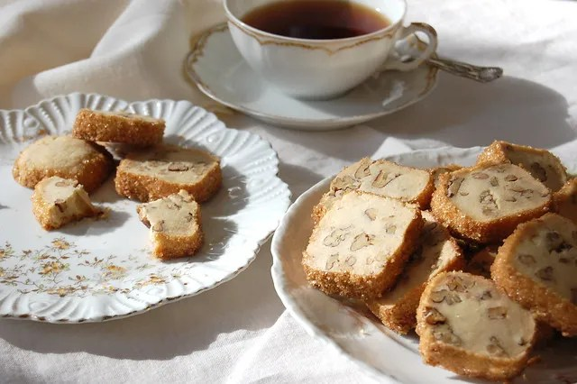 pecan shortbread cookies on antique china dishes with cup of tea