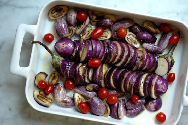 casserole of unbaked hasselback roasted eggplant with tomatoes