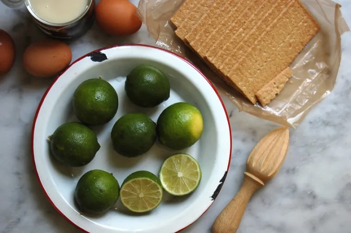 limes graham crackers eggs on marble key lime pie ingredients