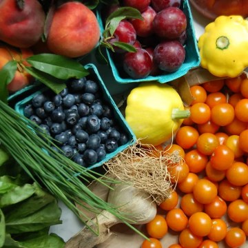 organic produce food like beries tomatoes chives plums squash