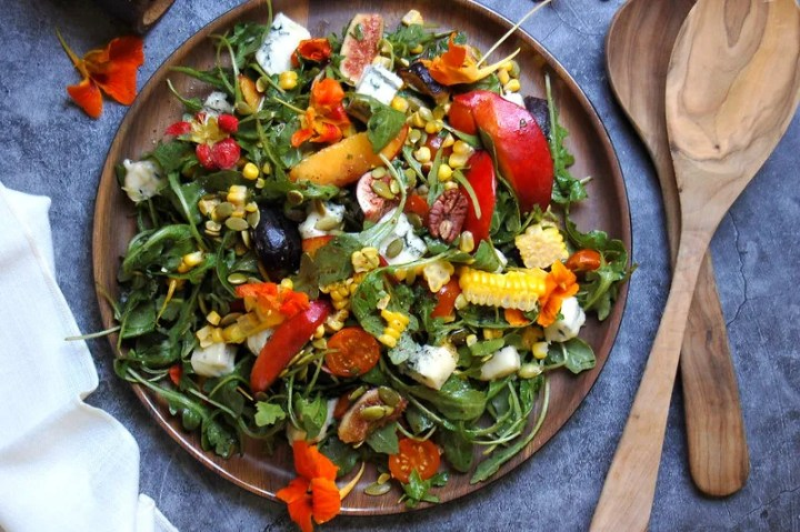 late summer salad with peaches gorgonzola figs on wood platter