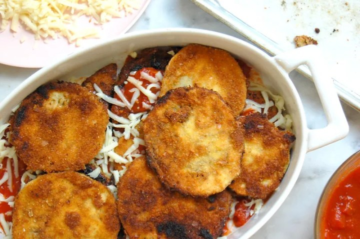 fried eggplant parmesan in casserole dish