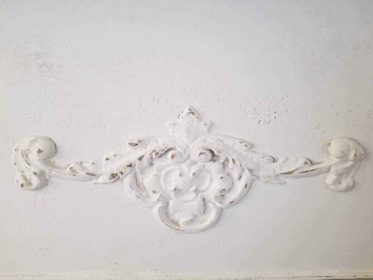 There are different methods of distressing painted furniture, to include dark wax, sanding and highlighting.